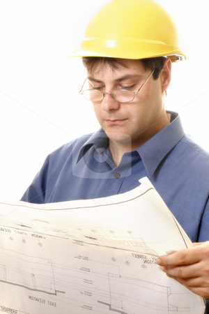 Architect or Project Manager stock photo, A man reading architectural plans by Leah-Anne Thompson