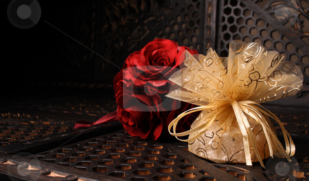 Golden Favour stock photo, Wedding Favour gift back with a red rose by Vanessa Van Rensburg