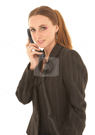 Young Caucasian businesswoman stock photo, Young adult caucasian businesswoman in a dark suit talking on a telephone, standing on a white background. NOT ISOLATED by Sean Nel