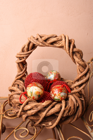 Christmas Basket with Balls stock photo, Woven Christmas basket on an old rustic bench by Vanessa Van Rensburg