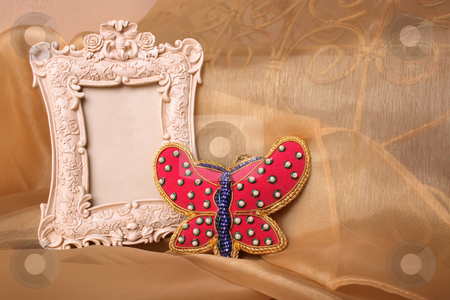 Picture Frame stock photo, Empty Picture frame and a red beaded butterfly by Vanessa Van Rensburg