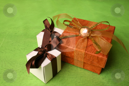 Brown and Copper stock photo, White and Copper gift boxes with ribbons and pebble by Vanessa Van Rensburg