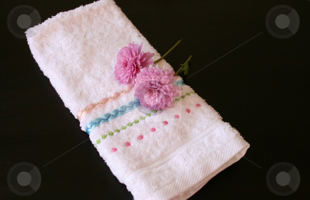 Two Pink stock photo, Two pink flowers on a hand towel by Vanessa Van Rensburg