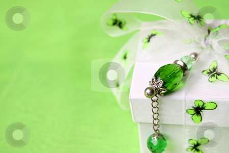 White Box stock photo, White gift box with green decorations and a crystal pin by Vanessa Van Rensburg