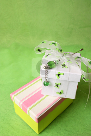 Gift Boxes stock photo, White and striped gift box with ribbons by Vanessa Van Rensburg
