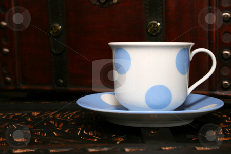 Tea Cup stock photo, Blue and white polka dot tea cup and saucer by Vanessa Van Rensburg