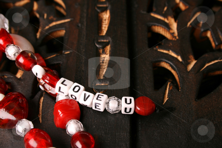 Valentine Beads stock photo, Red and white valentines beads with letters by Vanessa Van Rensburg