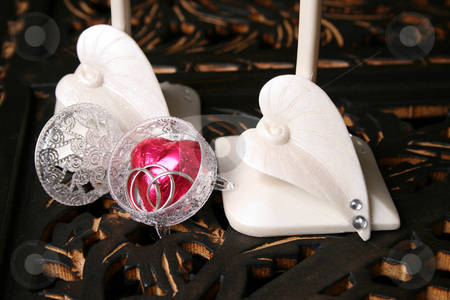 Valentines Proposal stock photo, Decorated long stem glasses with a chocolate heart and rings by Vanessa Van Rensburg