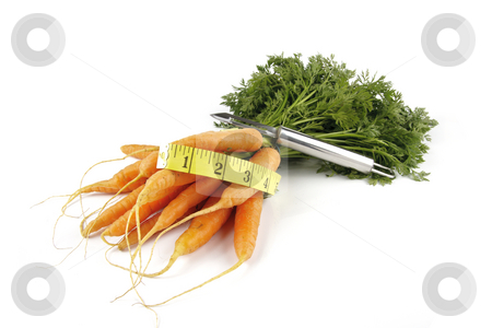 Bunch of Carrots with Peeler and Tape Measure stock photo, Fresh young bunch of carrots with green leafy stems and tape measure and chrome peeler on a reflective white background by Keith Wilson
