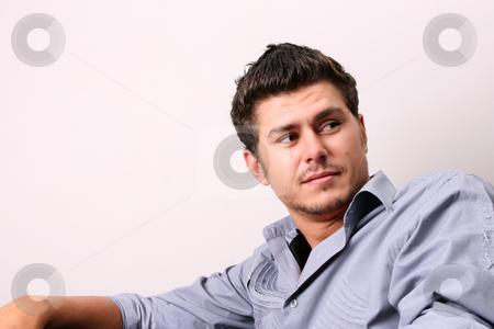 Peeping  stock photo, Male model in studio against white wall by Vanessa Van Rensburg