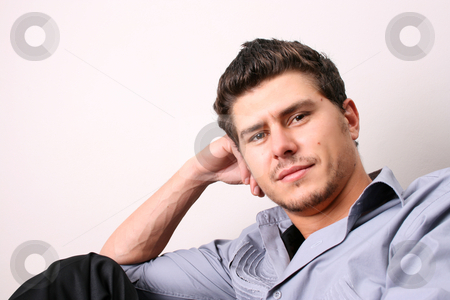 Relaxing stock photo, Male model in studio against white wall by Vanessa Van Rensburg