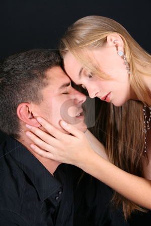 Young Couple stock photo, Young couple in love, faces close to one another by Vanessa Van Rensburg