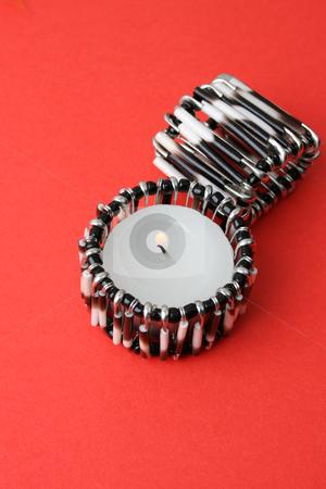 Tea Lights stock photo, Tea-lights in quill tea-light holders on a red background by Vanessa Van Rensburg