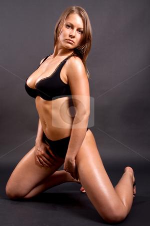 Beautiful woman in lingerie stock photo, Beautiful women posing in lingerie on a black background by Artem Zamula