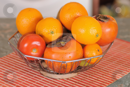 Fruit mix stock photo, Fresh ripe fruit in a metal vase on a table by Salauyou Yury