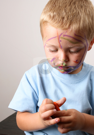 Orange stock photo, Laughing Toddler playing with colored pens making a mess by Vanessa Van Rensburg