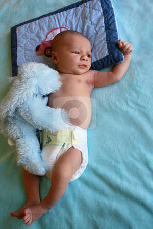 Baby Body stock photo, Week old baby boy on a blue blanket early in the morning by Vanessa Van Rensburg
