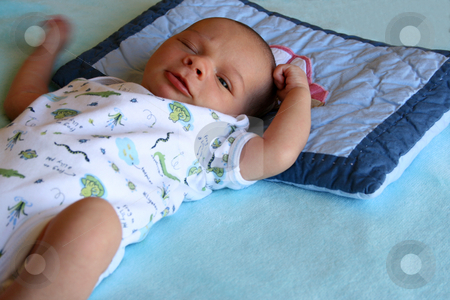 Winking stock photo, Week old baby boy on a blue blanket early in the morning by Vanessa Van Rensburg