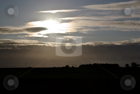 Moody Afternoon Sun stock photo, Sun hiding behind clouds in late afternnon by Stuart Atton