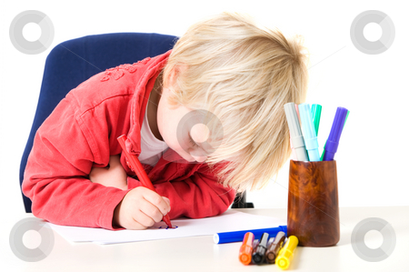 Concentrated drawing stock photo, Young blond boy in deep concentration drawing a butterfly with various felt tip pens by Corepics VOF