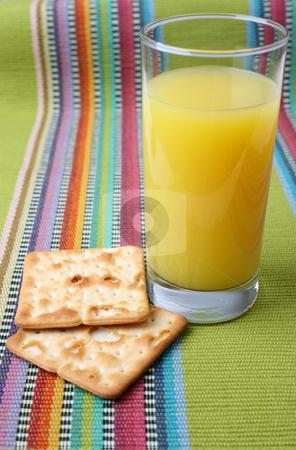 Orange Juice and Crackers stock photo, Glass of Orange Juice and two crackers by Vanessa Van Rensburg