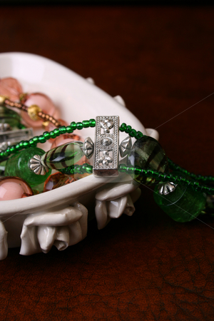 Jewelery stock photo, Beaded Jewelery set in a decorated ceramic dish by Vanessa Van Rensburg