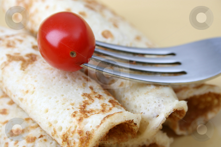 Pancakes stock photo, Close up of pancakes on a yellow plate by Vanessa Van Rensburg