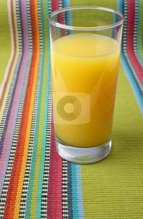 Single Glass stock photo, Glass of Orange Juice on a serviette by Vanessa Van Rensburg