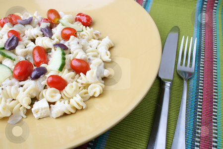 Pasta Salad Setting stock photo, Cold Pasta Salad with tomatoes, cucumbers and olives by Vanessa Van Rensburg