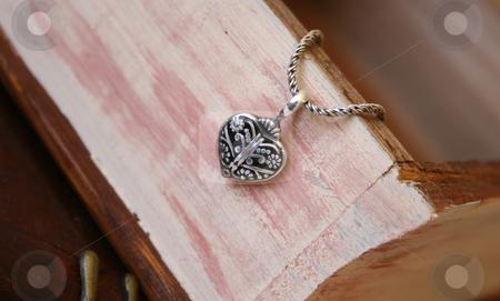 Silver Heart Jewellery stock photo, Silver Heart Jewellery on a woonden jewellery box by Vanessa Van Rensburg