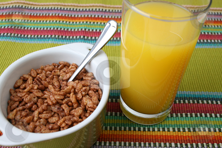 Breakfast Juice stock photo, Cereal in a green bowl with orange juice by Vanessa Van Rensburg