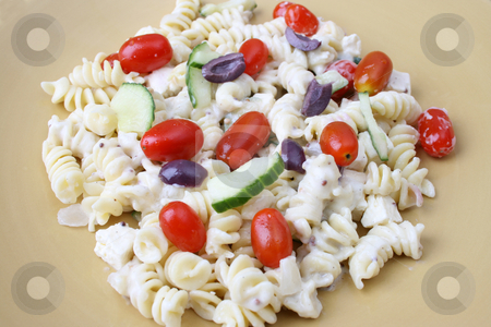 Pasta Salad in Yellow Plate stock photo, Cold Pasta Salad with tomatoes, cucumbers and olives by Vanessa Van Rensburg
