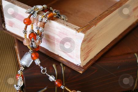 Orange Jewellery stock photo, Orange Jewellery hanging from an open wooden jewellery box by Vanessa Van Rensburg