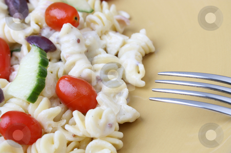 Pasta Salad with fork stock photo, Cold Pasta Salad with tomatoes, cucumbers and olives by Vanessa Van Rensburg