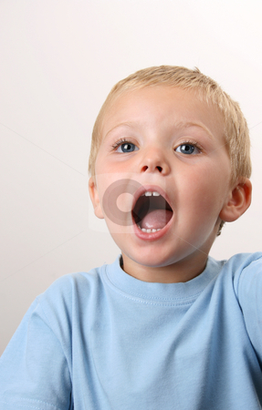 Open Mouth stock photo, Young boy with his mouth wide open wearing a blue shirt by Vanessa Van Rensburg