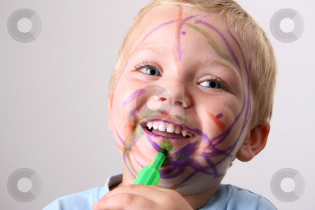 Funny Mess stock photo, Laughing Toddler playing with colored pens making a mess by Vanessa Van Rensburg