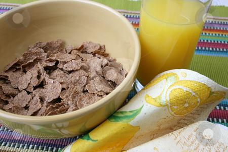 Breakfast Bran stock photo, Cereal in a green bowl with orange juice by Vanessa Van Rensburg