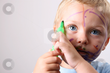 Concentrating stock photo, Laughing Toddler playing with colored pens making a mess by Vanessa Van Rensburg
