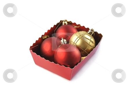 Christmas balls in the box. stock photo, Christmas ornaments in a box isolated over white. by Liana Bukhtyyarova