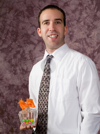 Man with candy dish stock photo, A young man wearing a shirt and tie, holding a candy dish with a bow on it by Richard Nelson
