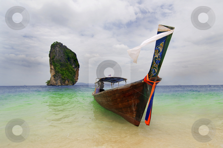 Longtailboat at the beach  stock photo, Longtailboat tied up at the beach in Thailand by Kjersti Jorgensen