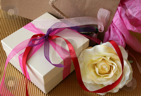 Gifts and Rose stock photo, Gift box, Gift bag an an artificial rose by Vanessa Van Rensburg