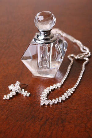 Glass and Diamonds stock photo, Glass bottle with a diamond jewelery set by Vanessa Van Rensburg