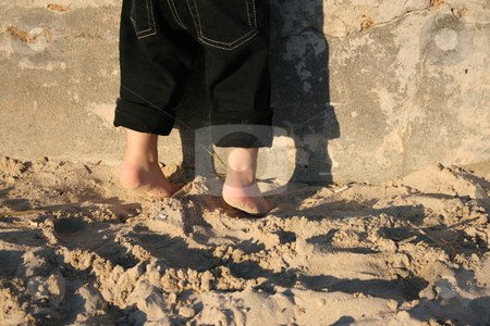 Two little feet stock photo, A child's feet on the beach standing halfway on his toes by Vanessa Van Rensburg