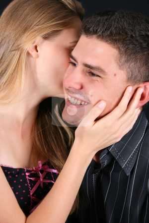 Whisper stock photo, Young couple, sweet secret whispers with a big smile by Vanessa Van Rensburg