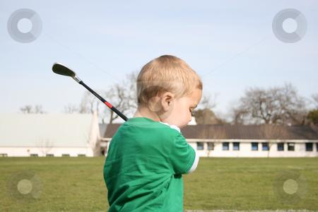 Golfing Toddler stock photo, Young boy practising golf on the driving rangeToddler practising golf on the driving range by Vanessa Van Rensburg