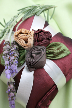 Fragrance Pillows stock photo, Burgundy Colored Fragrance Pillows with fresh lavendar by Vanessa Van Rensburg
