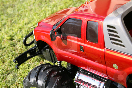 Toy Car stock photo, Red Toy car, radio controlled 4 x 4 scale vehicle by Vanessa Van Rensburg
