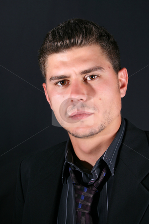 Male Model stock photo, Male model in studio against black background by Vanessa Van Rensburg