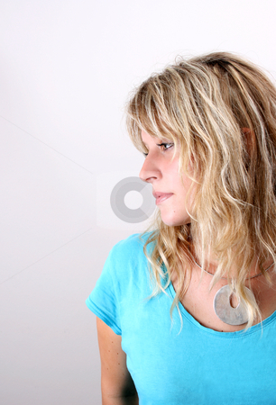 Blond Model stock photo, Blond Female model on a white background wearing a blue top by Vanessa Van Rensburg